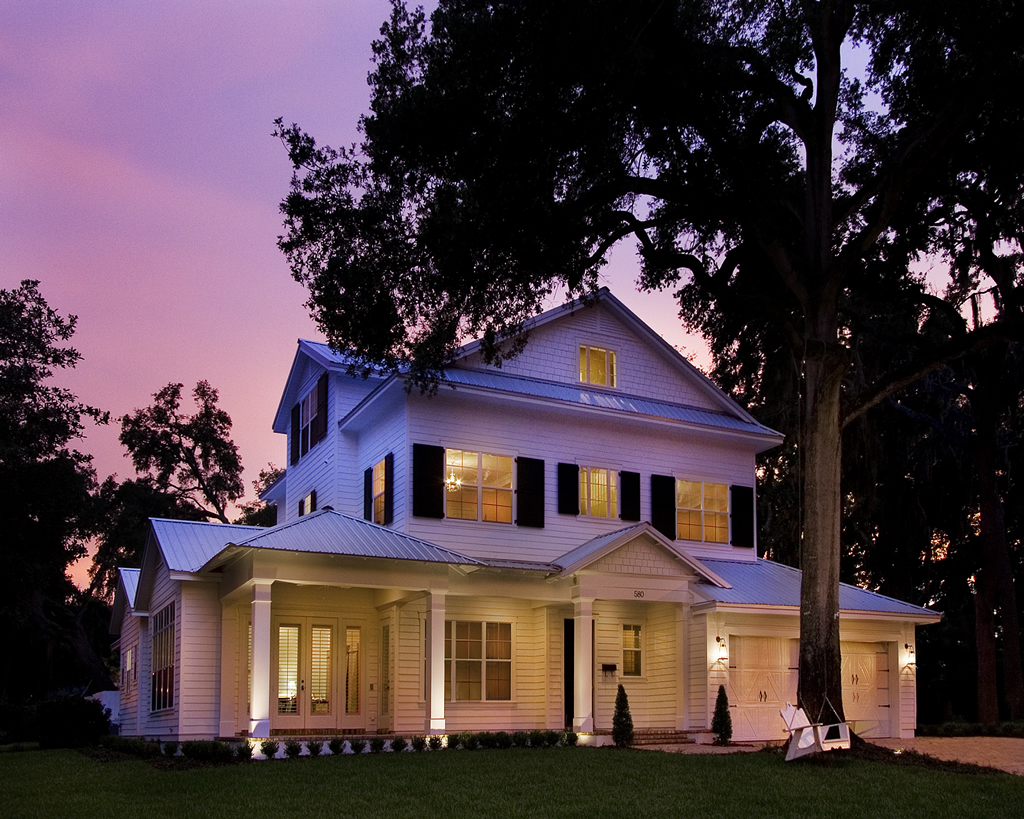 White house with black shutters at dusk