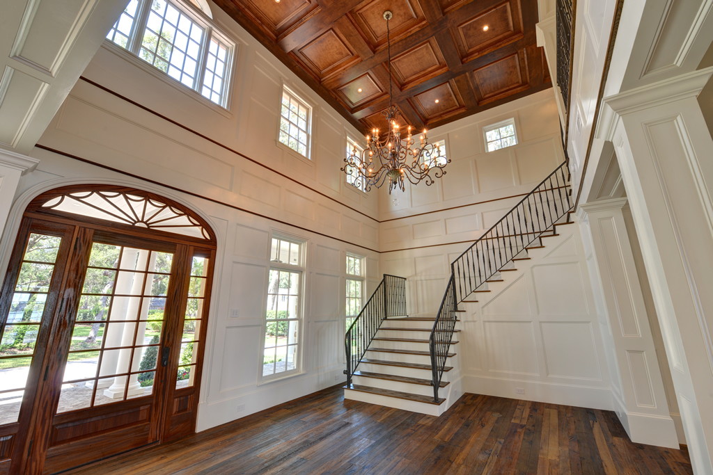 Inside entrance to home with wood floors and staircase