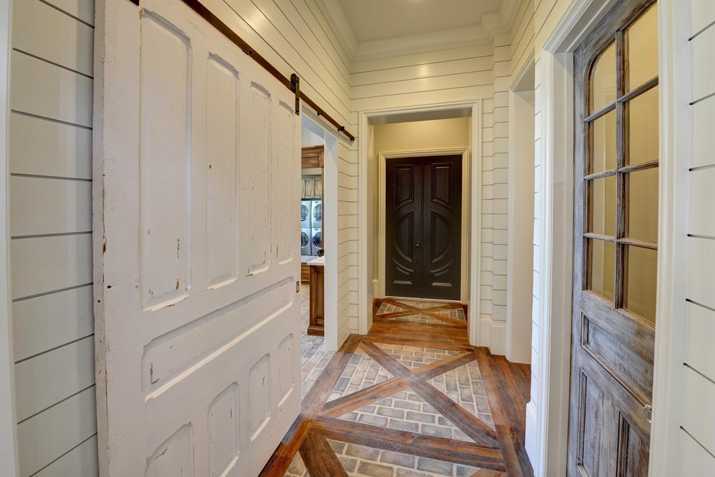 Hallway with sliding barn door