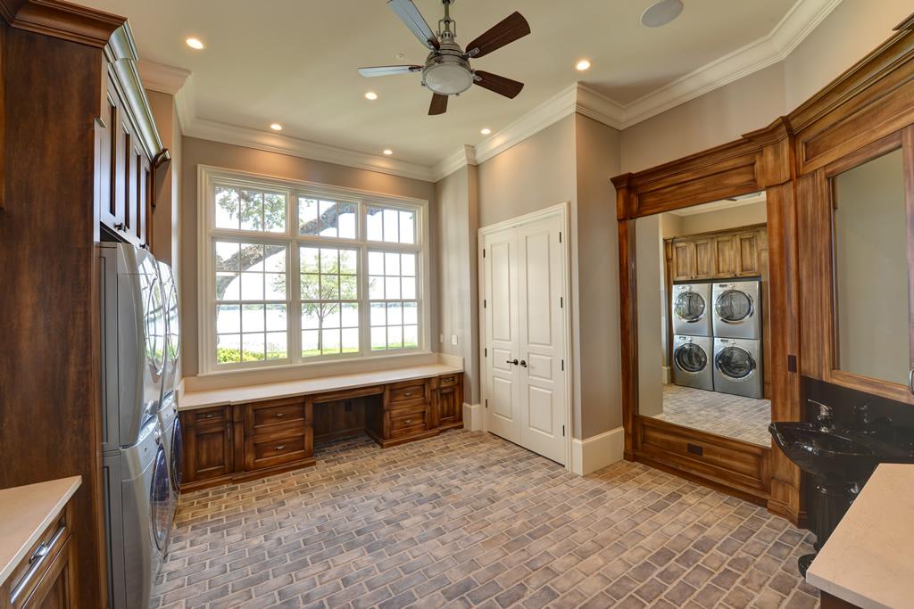 Laundry room with brick floors