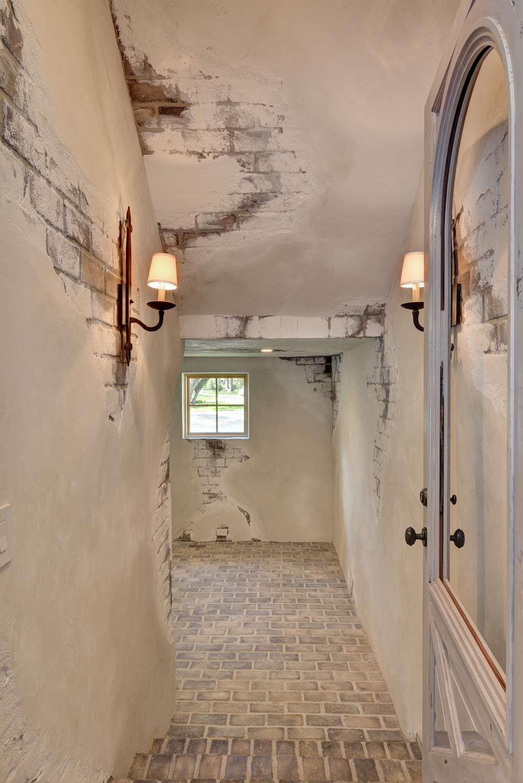 White washed brick floor and hallway
