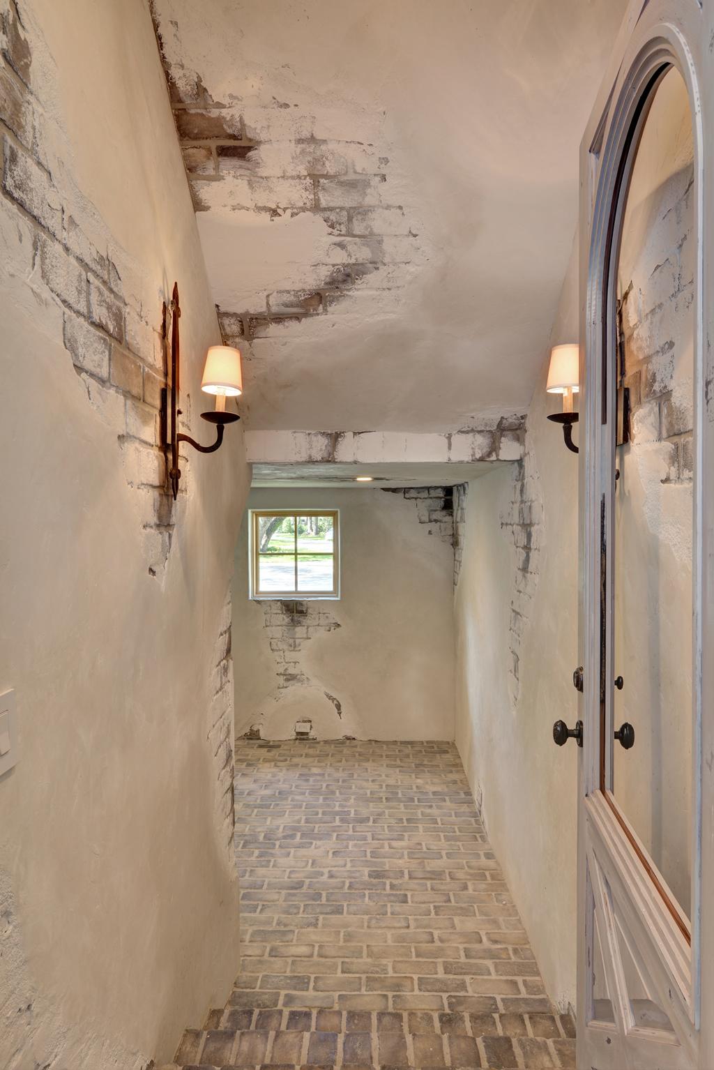 White washed brick floor and hallway