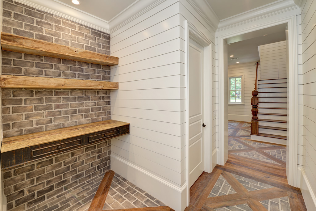 Pantry with wooden and brick and paneled walls