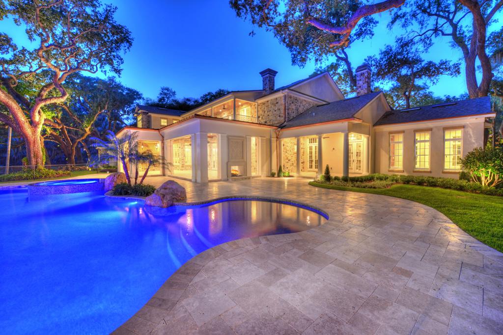 Backyard pool of stone house