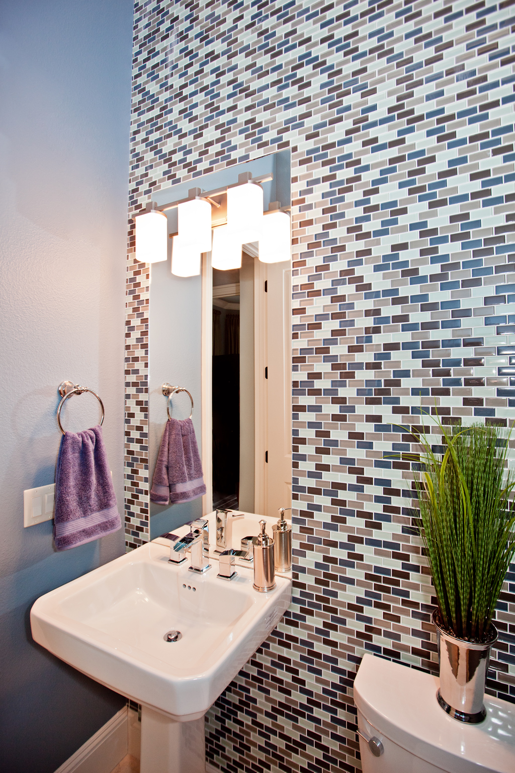 Bathroom Sink With Multi Colored Tiled Wall