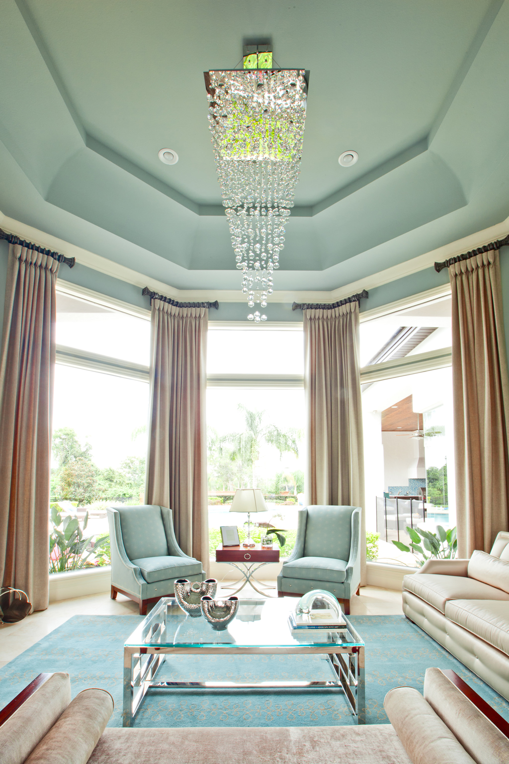 Chic furnished living room with chandelier