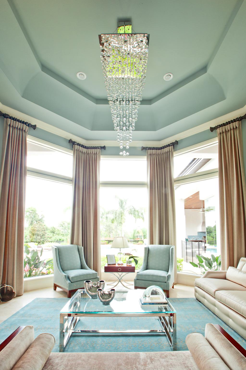 Chandelier hanging above furnished living room