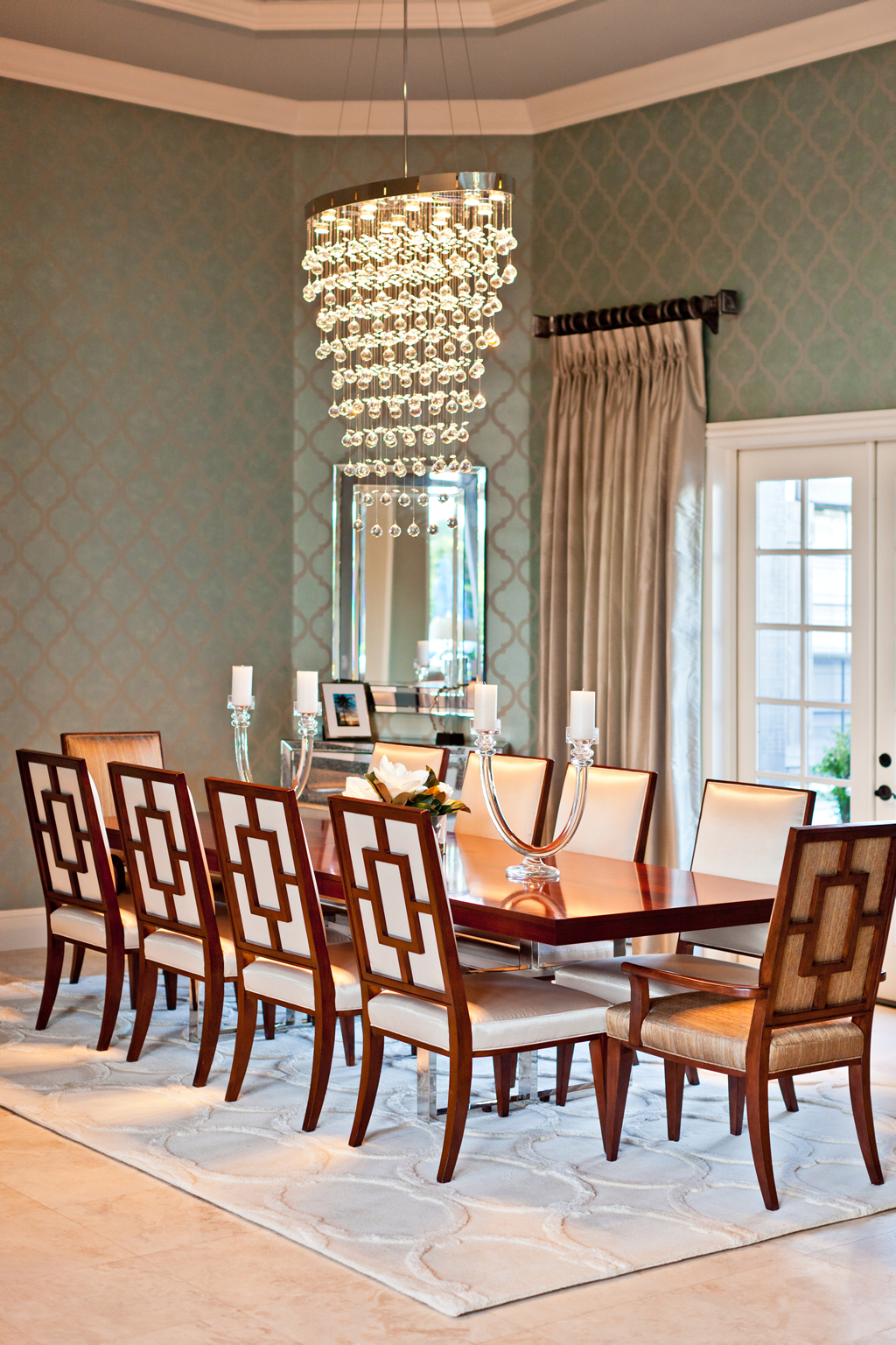 Chandelier above formal dining table and chairs