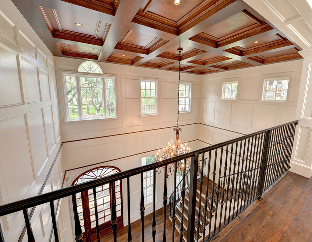 Inside of home with white paneled walls and hardwood floors