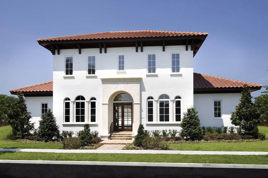 Street view of white stucco home