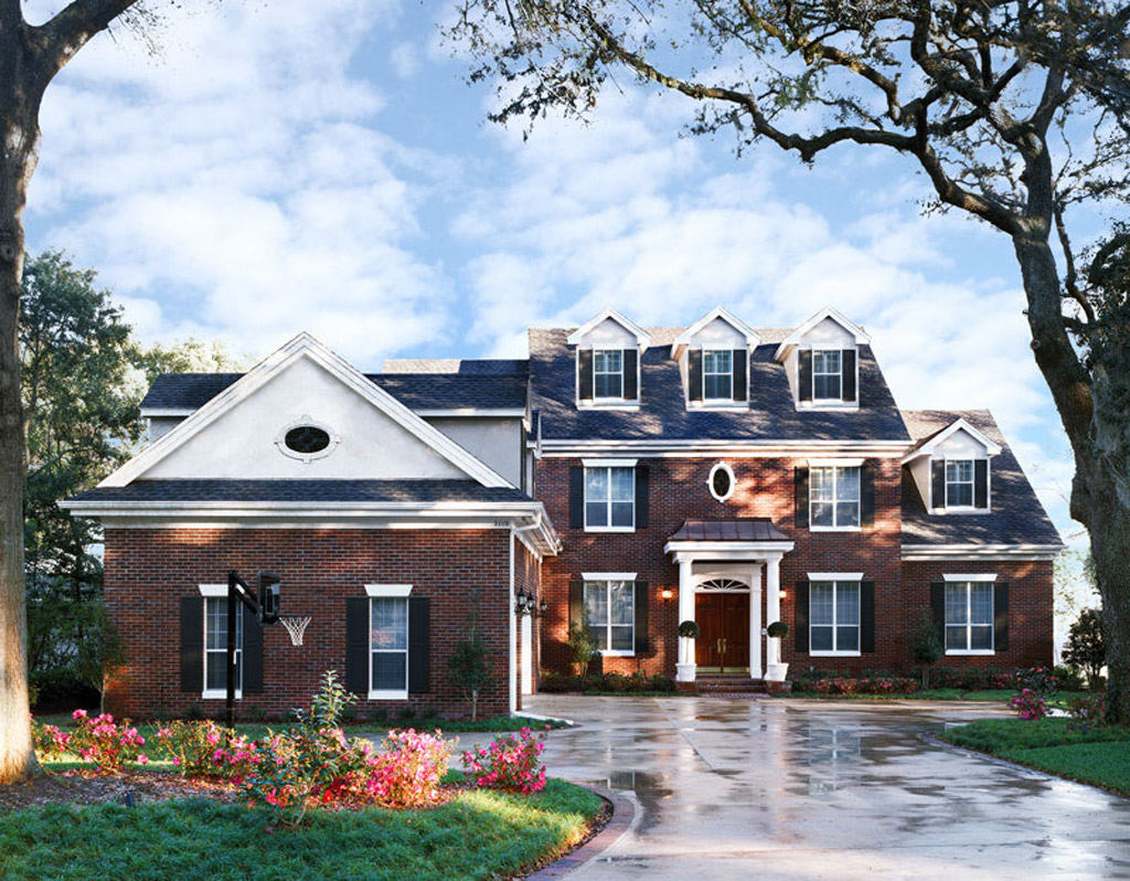 Brick house with wooden French front doors
