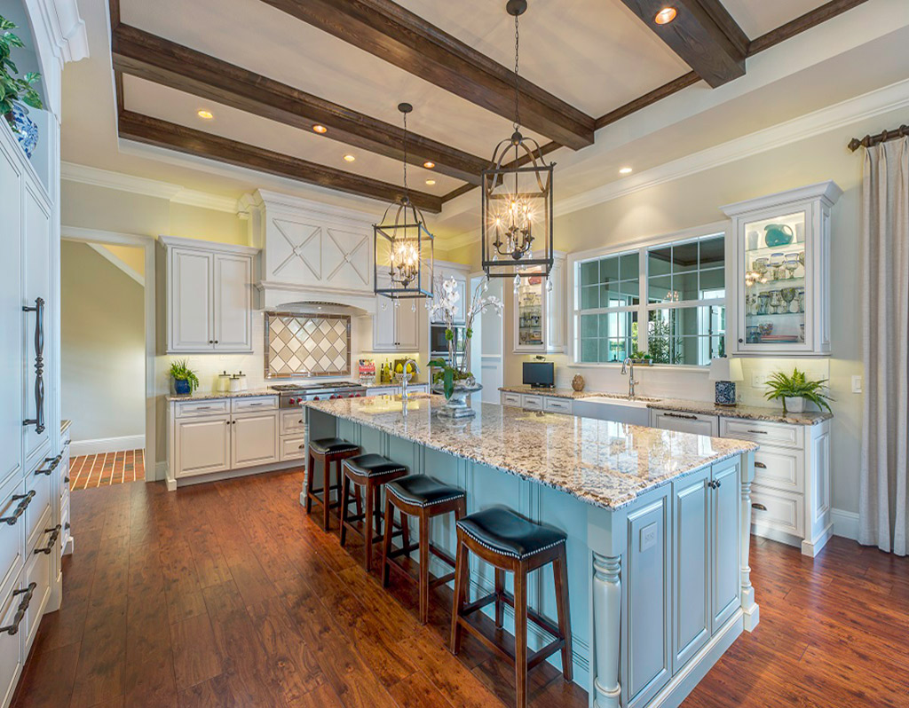 Kitchen with white cupboards and large island