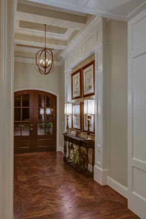Entryway with french doors and chandelier