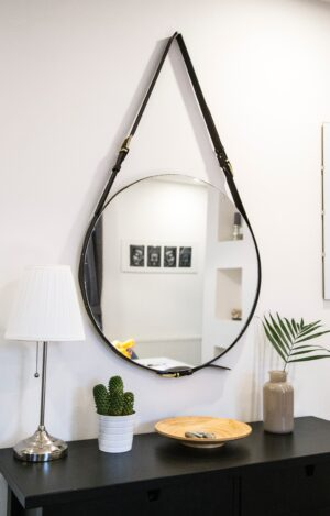 Circular mirror handing in entryway