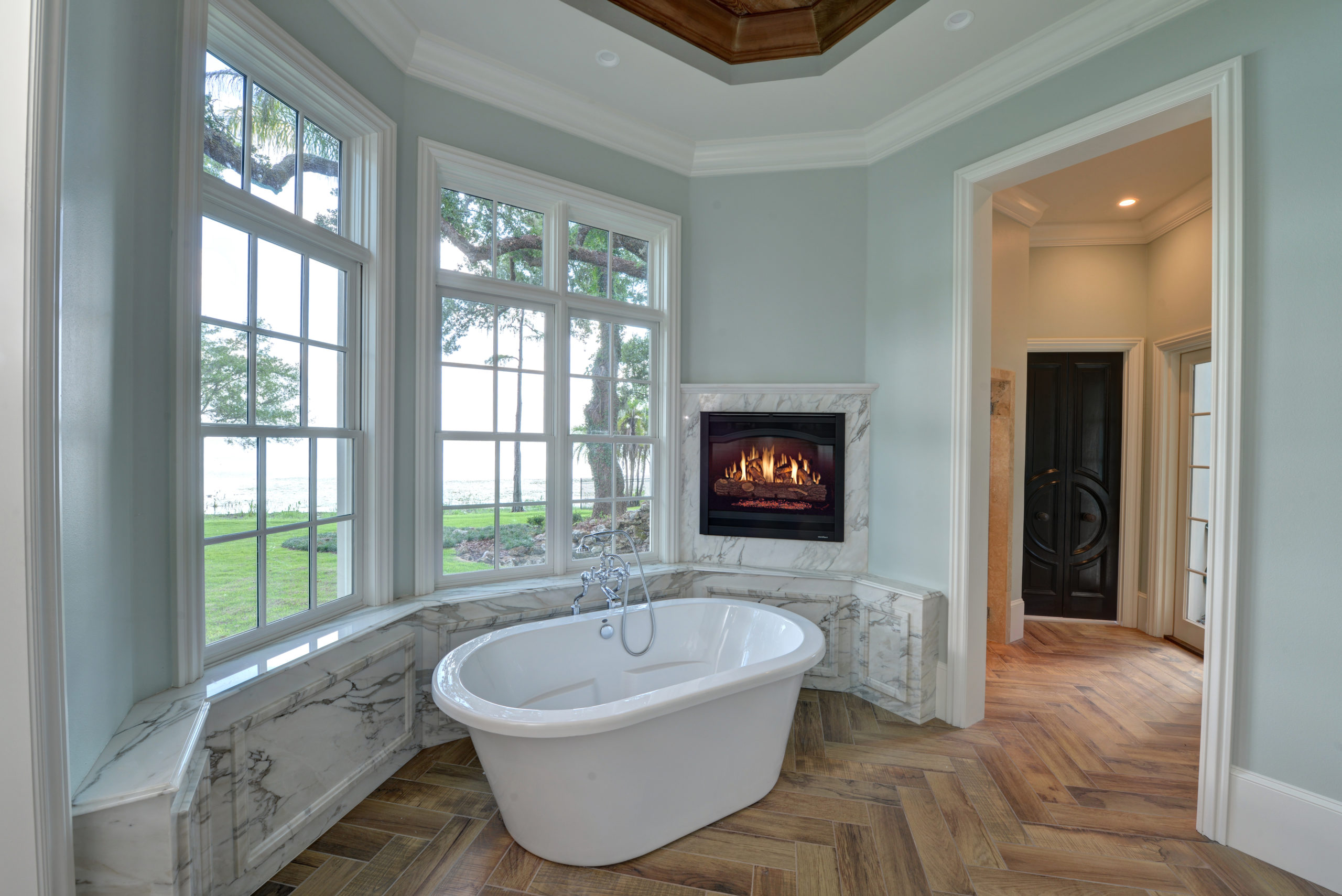Luxurious bathroom with jacuzzi tub and sitting place with fireplace