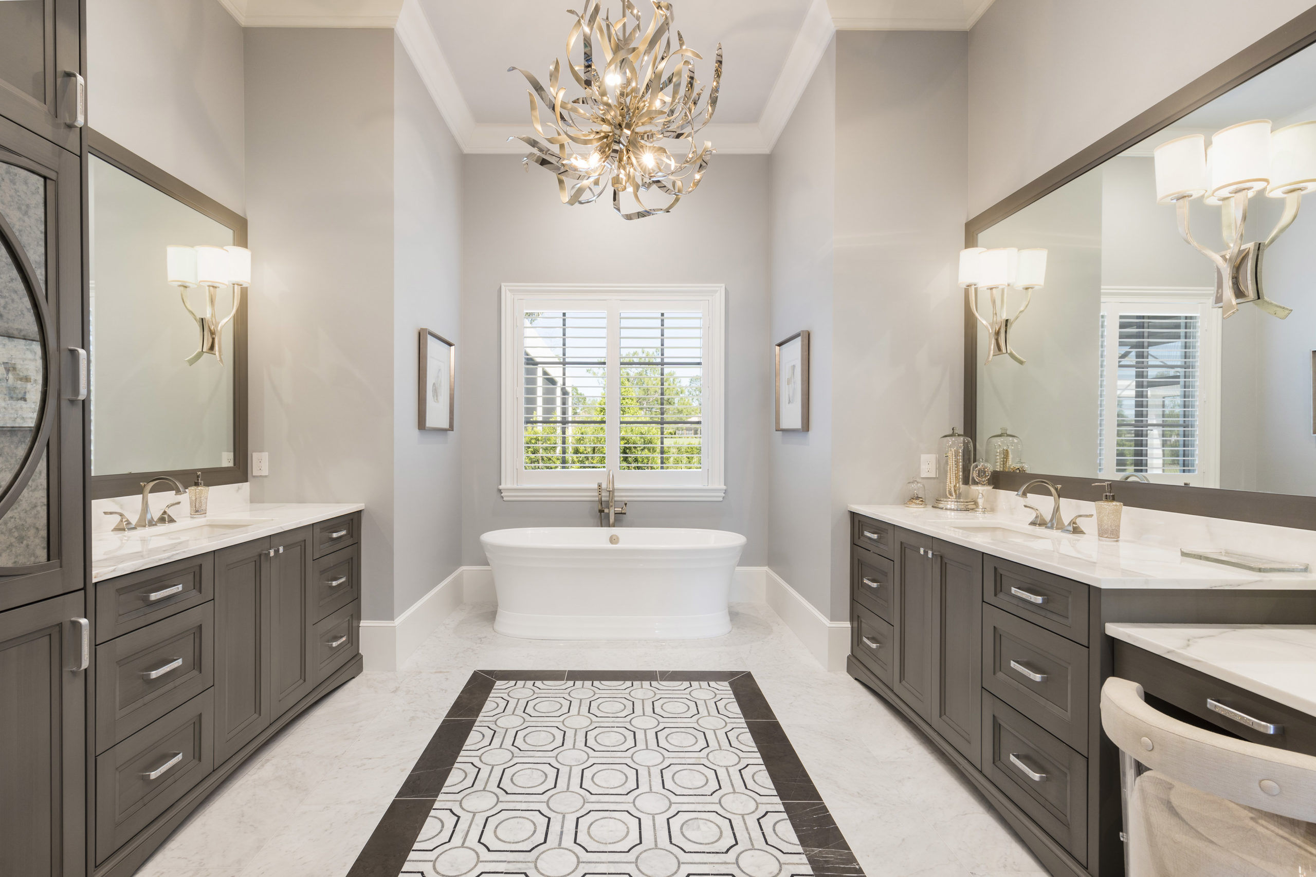 Master bedroom leading into master bathroom with separate bathtub